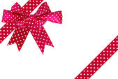 Image of red gift bow and ribbon on a white background — Stock Photo