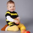 Little baby with apples — Stock Photo