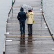 Ouple on a Rainy Pier — Stock Photo