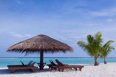 Relaxing chairs in front of the Indian Ocean in Maldive Islands — Zdjęcie stockowe
