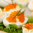 Eggs with red caviar - Stock Photo