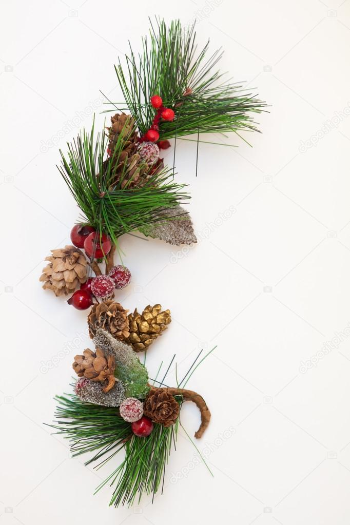 Christmas ornament with pine cones on white background  Foto Stock #13985899