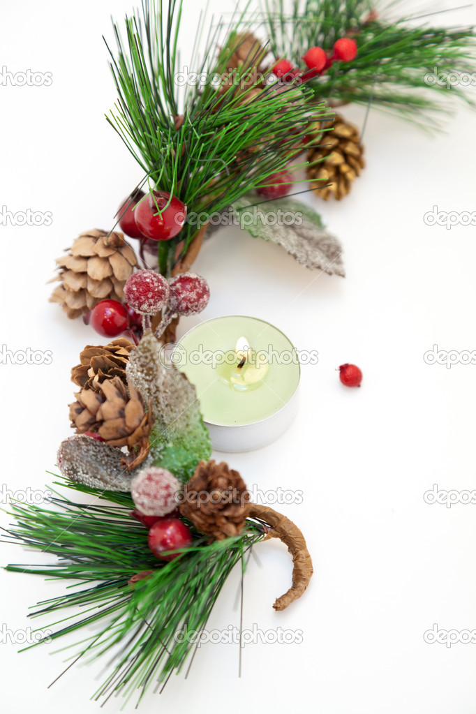 Christmas ornament with pine cones and little candle — Stock Photo #13985900