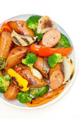 Grilled kielbasa and vegetables — Stock Photo