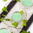 Candle and Ivy leaves — Stock Photo