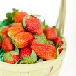 Fresh strawberries in basket - Stock Photo