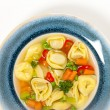 Tortellini soup - Stock Photo