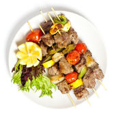 Kebabs with peppers, tomato and onion — Stock Photo
