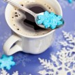 Coffee with snowflakes shaped sugar — Photo