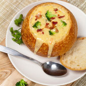 Sourdough bread bowl filled with broccoli cheese soup — Stok fotoğraf