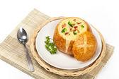 Sourdough bread bowl filled with broccoli cheese soup — Foto de Stock