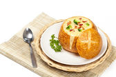 Sourdough bread bowl filled with broccoli cheese soup — Stock Photo