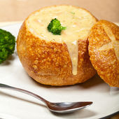 Broccoli cheese and bacon soup in a bread bowl — Stock Photo