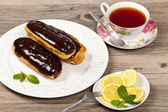 Chocolate eclairs — Stock Photo