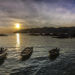 Three Fish boats with a setting sun — Stock Photo #32192681