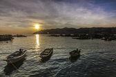 Three Fish boats with a setting sun — Stock Photo
