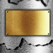 Golden plaque on metal background - Stock Photo