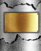 Golden plaque on metal background — Stock Photo