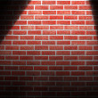 Spotlight on wall — Stockfoto