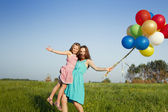 Mother and daughter with balloons, portrait — Stock Photo