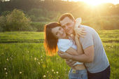 Happy couple at sunset — Stock Photo