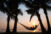 Sunset in hammock on the beach — Stock Photo