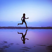 Female runner silhouette — Stockfoto