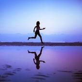 Female runner silhouette — Stock Photo