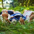 Stock Photo: Family relaxing on grass