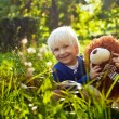 Boy with teddy bear — Stockfoto