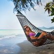 Sexy woman in hammock — Stock Photo