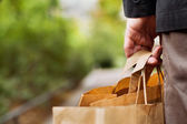 Man's hand with shopping bags — Stock Photo