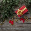 Christmas tree branch with gift and decorations — Stock Photo