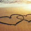 Hearts sign on the sand — Stockfoto
