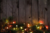 Branches of a Christmas tree with multicolored luminous garland — Stockfoto