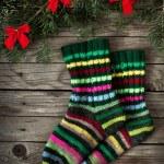 Christmas socks and fir tree — Stock Photo #34910407