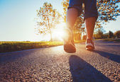 Runner feet on the road — Stock Photo