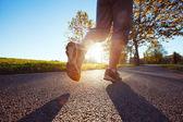 Runner feet on road — Stock Photo