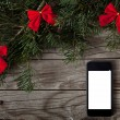 Smartphone on christmas background — Stock Photo