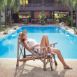 Stock Photo: Womin deck chair