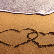 Two hearts on beach — Stock Photo