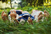Feet in grass — Stock fotografie