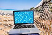 Laptop in hammock — Stock Photo