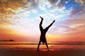 Man jumping on the beach — Stock Photo