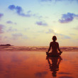 Woman meditating on the beach — Stock Photo #47106435