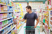 Man in supermarket — Stock Photo