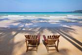 Two sun loungers on the beach — 图库照片