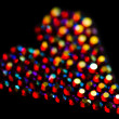 Foto Stock: Colorful strass heart pattern on black background