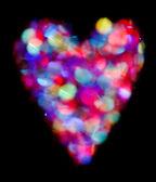 Contorno del cuore luminoso bokeh colorate su sfondo nero — Foto Stock