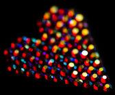 Siyah arka plan üzerinde renkli p.kodu kalp şekli — Stok fotoğraf